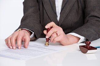 Estate Planning — Man In Suit Signing Documents in Louisville, KY